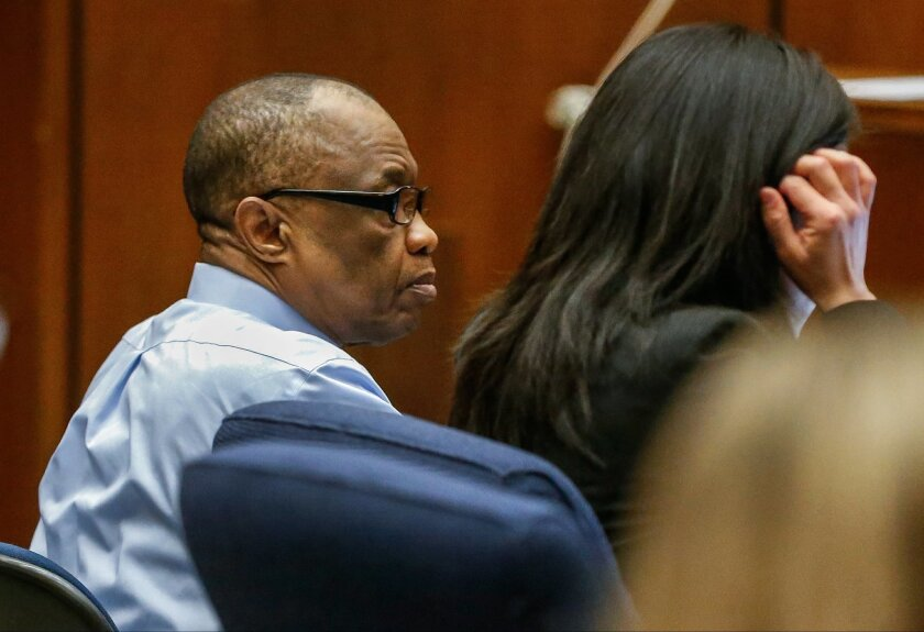 Lonnie Franklin Jr., left, appears in Los Angeles Superior Court for opening statements in his trial on Tuesday, Feb. 16, 2016, in Los Angeles. Franklin has pleaded not guilty to killing nine women and a 15-year-old girl between 1985 and 2007 in one of the city's most notorious serial killer cases.