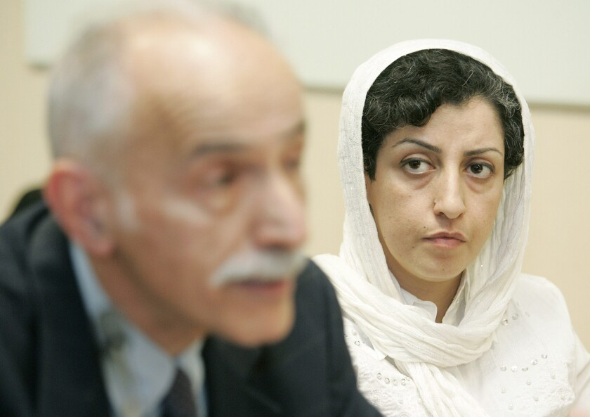 Narges Mohammadi, right, attends a news conference in Geneva in 2008.