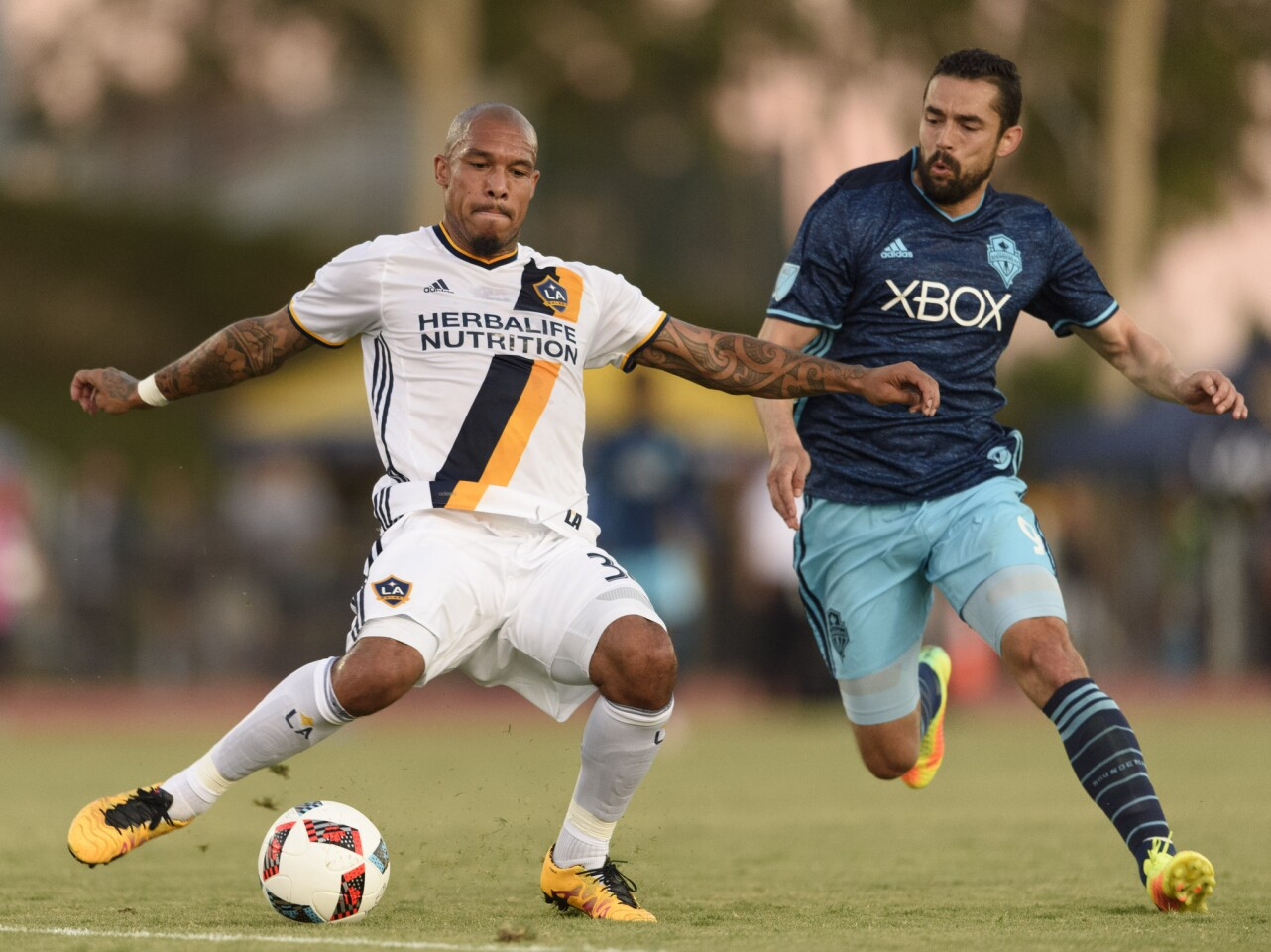 Jul 20, 2016; Los Angeles, CA, USA; LA Galaxy midfielder Nigel de Jong (34) moves the ball defended by Seattle Sounders FC forward Herculez Gomez (9) during the first half at StubHub Center. Mandatory Credit: Kelvin Kuo-USA TODAY Sports ** Usable by SD ONLY **