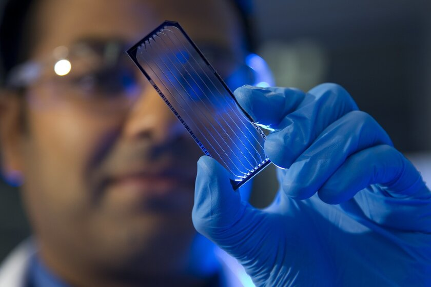 Illumina clinical lab manager Suneer Jain holds flow cell for whole human genome sequencing in a file photo. San Diego ranked as the fifth for innovation job growth from 2005 to 2017.