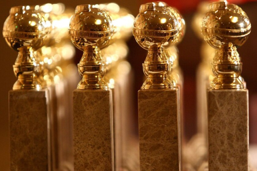 Rows of Golden Globe statuettes
