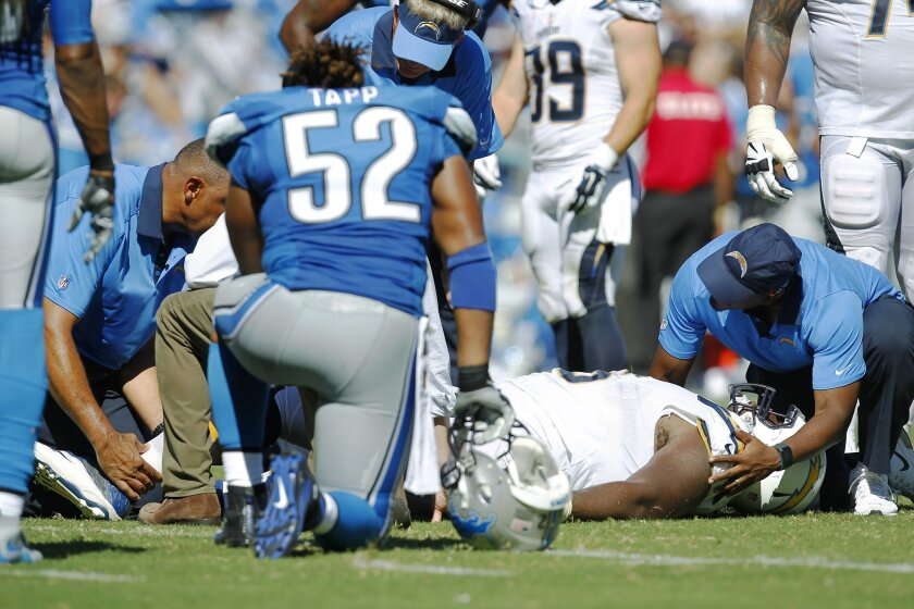 Chargers right guard D.J. Fluker is treated for an ankle injury in the season opener against the Detroit Lions.