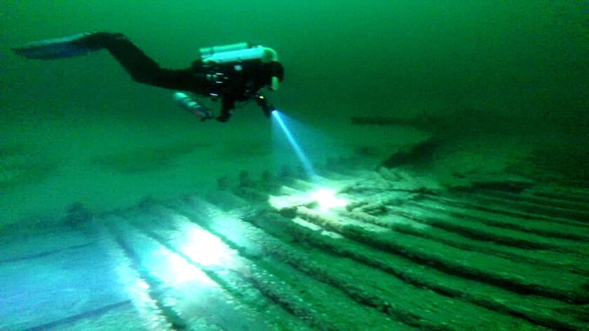 This image taken from video shows diver Andrew Driver swimming over part of a 19th-century canal boat that lies on the floor of Lake Ontario's eastern end near Oswego, N.Y. Jim Kennard, Roger Pawlowski, and Roland Steven, three underwater explorers from the Rochester area, said, Wednesday, Jan. 21,