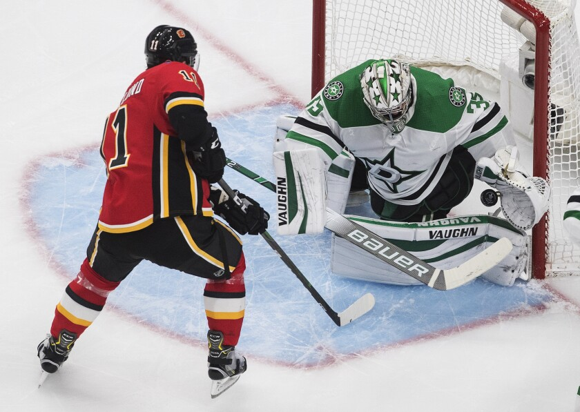 Calgary Flames' Mikael Backlund (11) scores on Dallas Stars goalie Anton Khudobin (35) during the second period in the first round NHL Stanley Cup playoff hockey series, Friday, Aug. 14, 2020, in Edmonton, Alberta. (Jason Franson/The Canadian Press via AP)