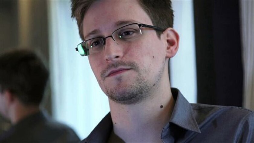 This photo, taken June 9, 2013, in Hong Kong, provided by The Guardian Newspaper in London shows Edward Snowden, who worked as a contract employee at the National Security Agency. Civilian U.S. government scientists worried even a generation ago about the National Security Agency's role in developing global communications standards, according to documents reviewed by The Associated Press. Some scientists wondered why the NSA appeared to choose weaker standards then classified its explanation as