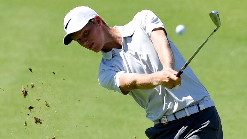 Cameron Davis plays his second shot at the 13th hole during the first round of the Australian Open on Thursday.