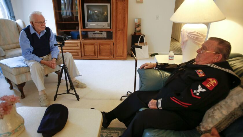 In the living room of his home in Rancho Bernardo, Stan Smith, 89, interviews World War II veteran Gil Nadeau, 90, of Escondido for the Veteran History Project.