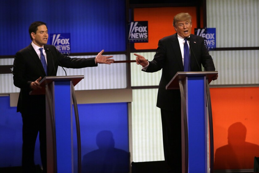 Republican presidential candidates Sen. Marco Rubio, left, and businessman Donald Trump argue during a Republican primary debate on Thursday at Fox Theatre in Detroit.