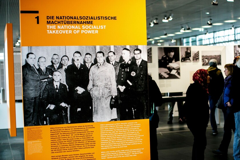 A Berlin museum exhibit on Jan 27, Holocaust Remembrance Day, displays a photograph of Nazi leaders, including Adolf Hitler.