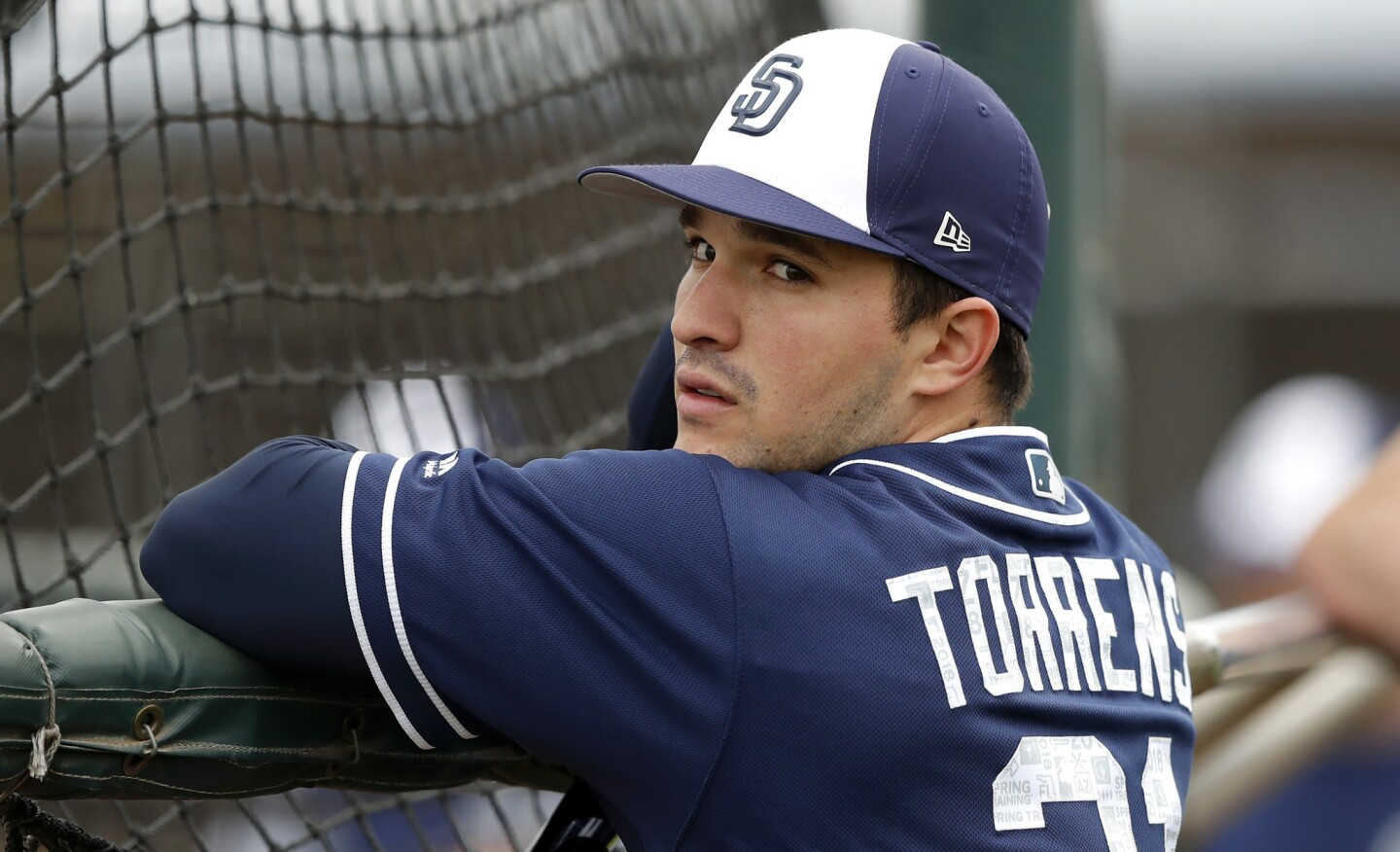San Diego Padres catcher Luis Torrens waits to hit in the batting cage during a baseball spring training workout, Friday, Feb. 16, 2018, in Peoria, Ariz. (AP Photo/Charlie Neibergall)