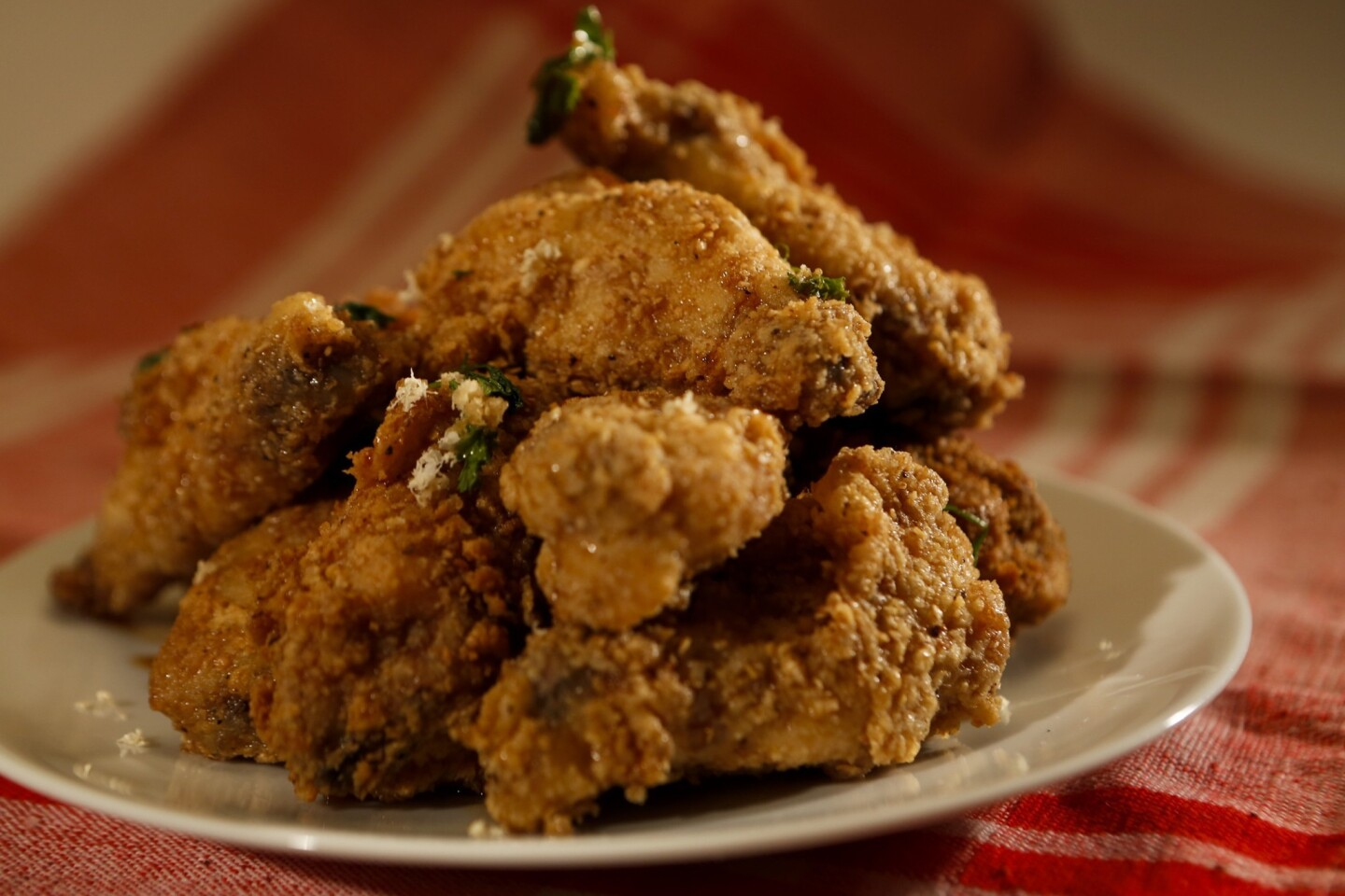 Crispy apple wings are flavored with fresh horseradish and curly parsley. Recipe: Apple wings