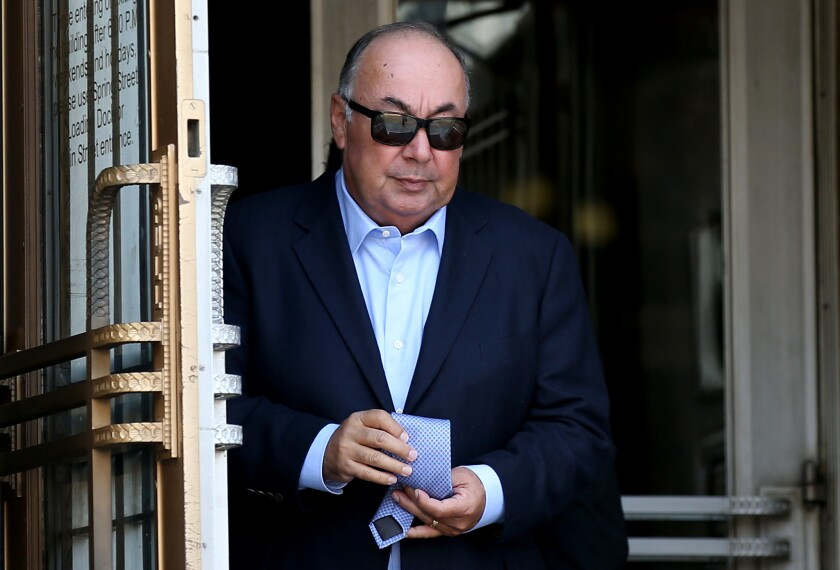 Former California Assemblyman Tom Calderon leaves federal court in Los Angeles after a sentencing hearing Monday.