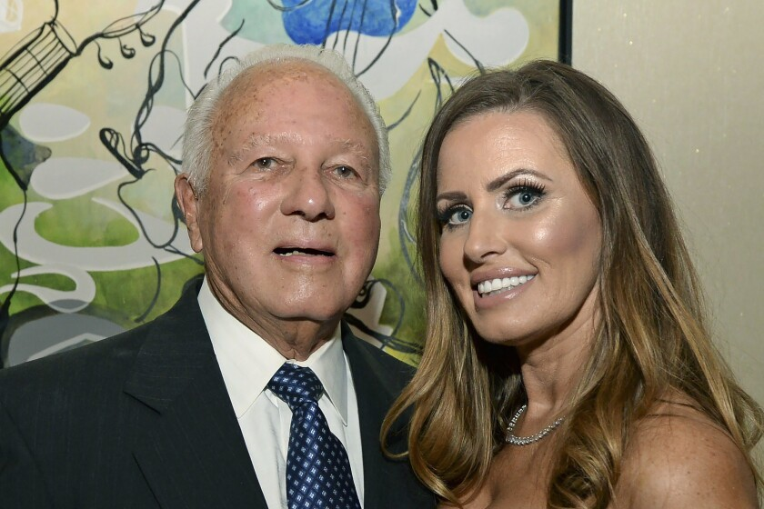 Former Governor Edwin Edwards kisses his new bride, Trina Grimes Scott, in 2011