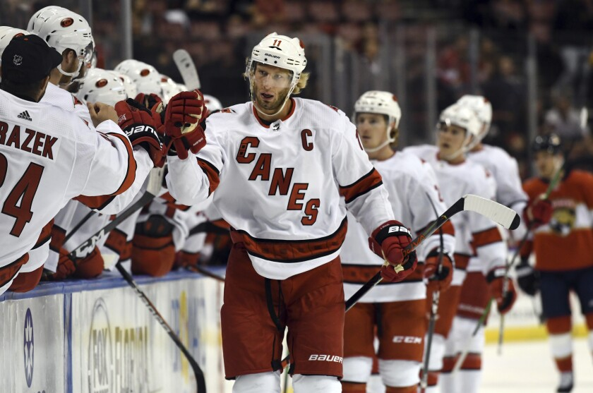 Carolina Hurricanes center Jordan Staal (11) celebrates a goal during the first period of an NHL hockey game against the Florida Panthers. Tuesday, Oct. 8, 2019, in Sunrise, Fla. (AP Photo/Jim Rassol)