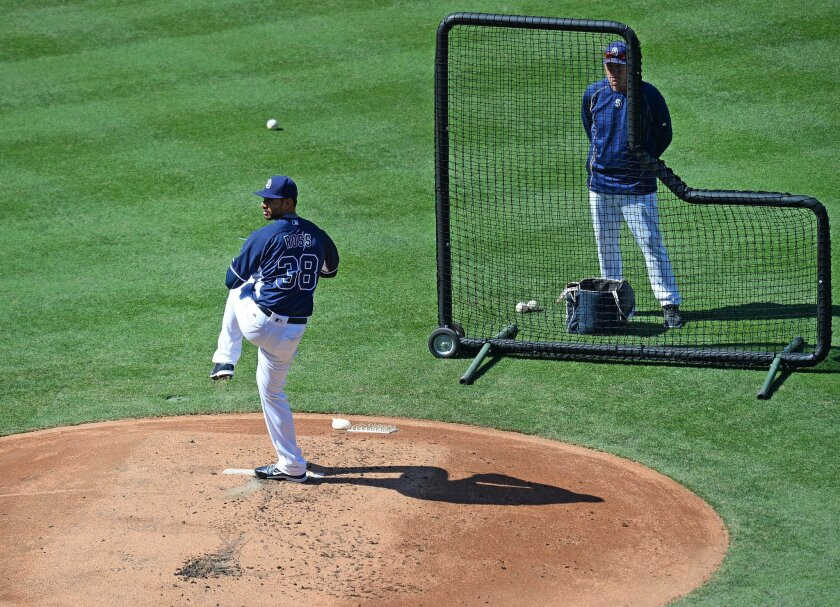 Aug 20, 2016; San Diego, CA, USA; San Diego Padres starting pitcher Tyson Ross (38) throws live batting practice as pitching coach Darren Balsley (36) watches before the game against the Arizona Diamondbacks at Petco Park. Mandatory Credit: Jake Roth-USA TODAY Sports ** Usable by SD ONLY **