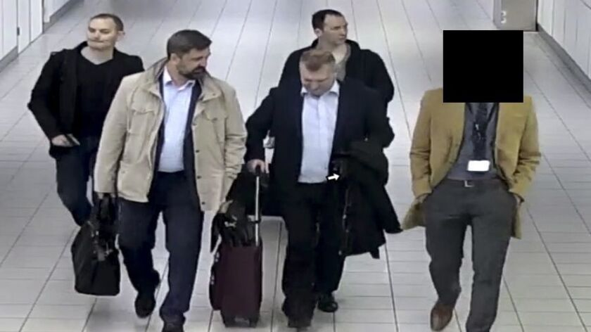 Four Russian officers of the GRU are escorted to their flight after being expelled from the Netherlands on April 13 for allegedly trying to hack into the network of the Organization for the Prohibition of Chemical Weapons, a U.N. watchdog agency.