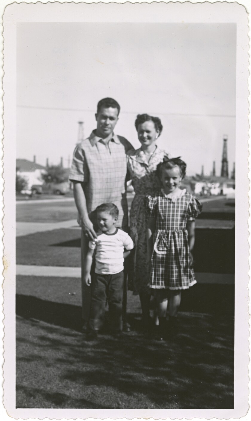 Billie Jean King as a child with her parents and brother Randy in their front yard in Long Beach, California.