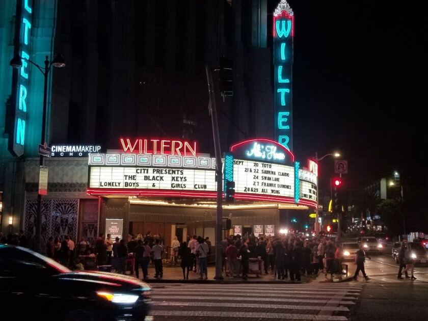 Fans crowd the sidewalk outside the Wiltern after being turned away at the door