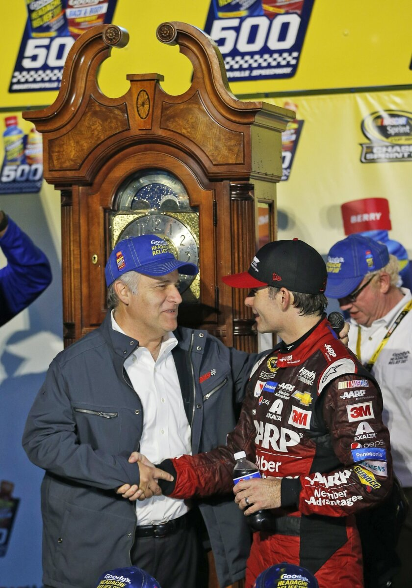 In this photo taken Nov. 1, 2015, Jeff Gordon, right, shakes the hand of Martinsville Speedway president Clay Campbell, left, in Victory Lane as he celebrates winning the Sprint Cup auto race at the Martinsville Speedway in Martinsville, Va. At the zenith of its popularity a decade or so ago, many