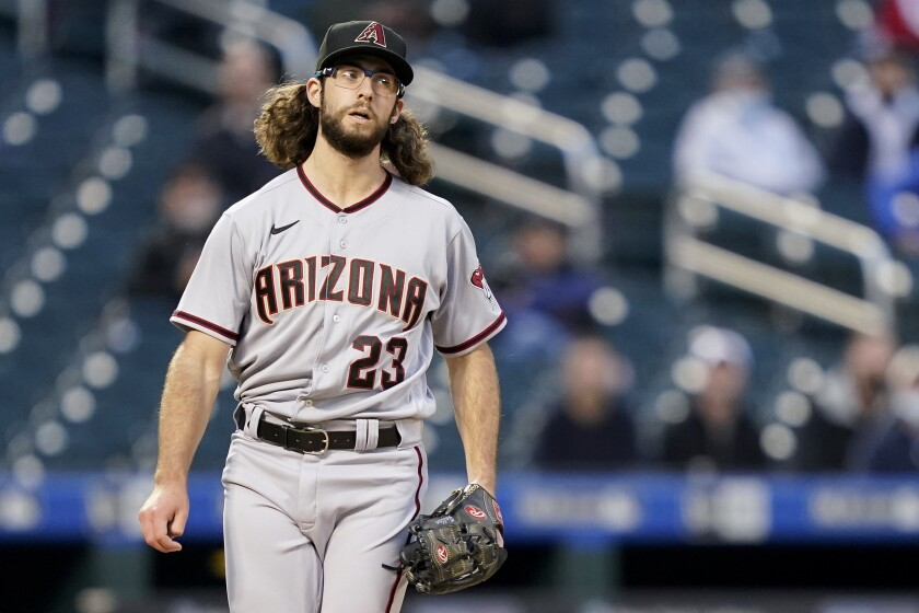 Arizona Diamondbacks starting pitcher Zac Gallen reacts after throwing in the first inning of a baseball game against the New York Mets, Friday, May 7, 2021, in New York. (AP Photo/John Minchillo)