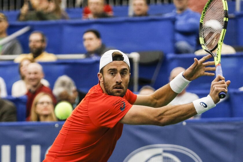 Steve Johnson of the U.S. returns the ball against Taylor Fritz of the U.S. during the fourth day of the Memphis Open tennis tournament in Memphis, Tenn., Thursday, Feb. 11, 2016. (Brad Vest/The Commercial Appeal via AP) MANDATORY CREDIT