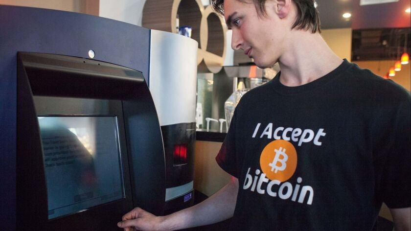 Gabriel Scheare uses the world's first bitcoin ATM in October 2013 at Waves Coffee House in Vancouver, Canada.
