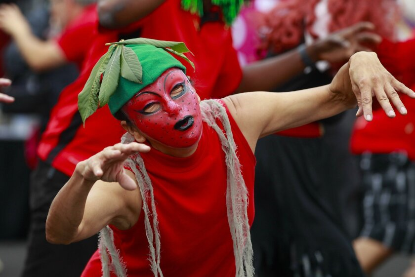 Dressed as a strawberry, Ana Tapia performs with the group Poway Thriller Dancers at the Vista Strawberry Festival Sunday.