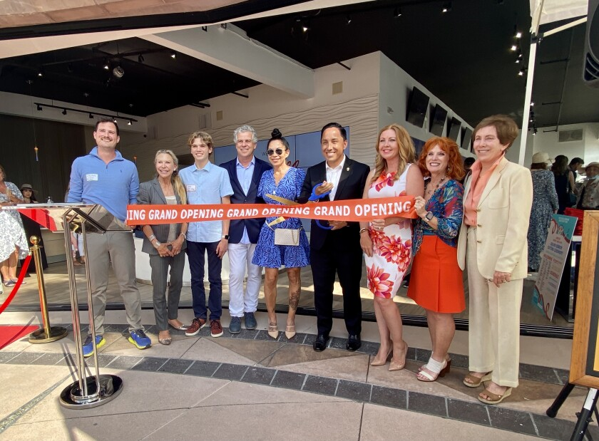 San Diego Mayor Todd Gloria cuts a ribbon along with several new La Jolla business owners in a June 15 ceremony.