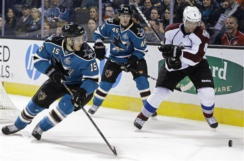 Colorado Avalanche's Jan Hejda, right, advances the puck against San Jose Sharks' James Sheppard (15) and Tim Kennedy (46) during the second period of an NHL hockey game Tuesday, Feb 26, 2013, in San Jose, Calif. (AP Photo/Ben Margot)