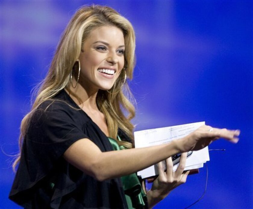 "FILE -- In this April 26, 2009 file photo, Miss California, Carrie Prejean, waves as she comes on stage at the Rock Church during services in San Diego. PreJean said she'll be working with the National Organization for Marriage to ""protect traditional marriages. In recent weeks, Vermont and Iowa have legalized same-sex marriage while New York, Maine and New Hampshire have taken steps in that direction. (AP Photo/Denis Poroy, File)"