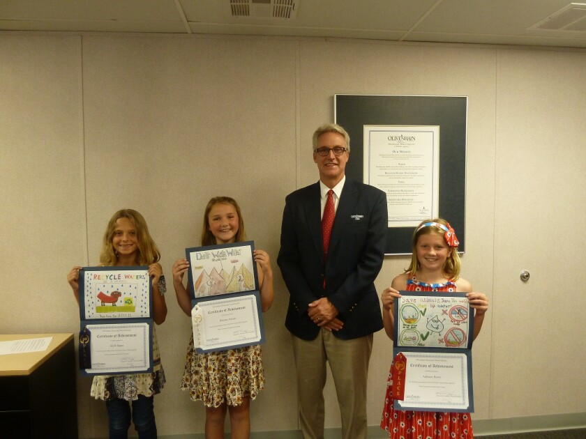 The Olivenhain Municipal Water District recently recognized the winners of the 2019 North County Water Agencies Water Awareness Poster Contest: from left, Sayla Egger, first; Addison Bowe, second; Board President Ed Sprague; Delaney Owens, third.