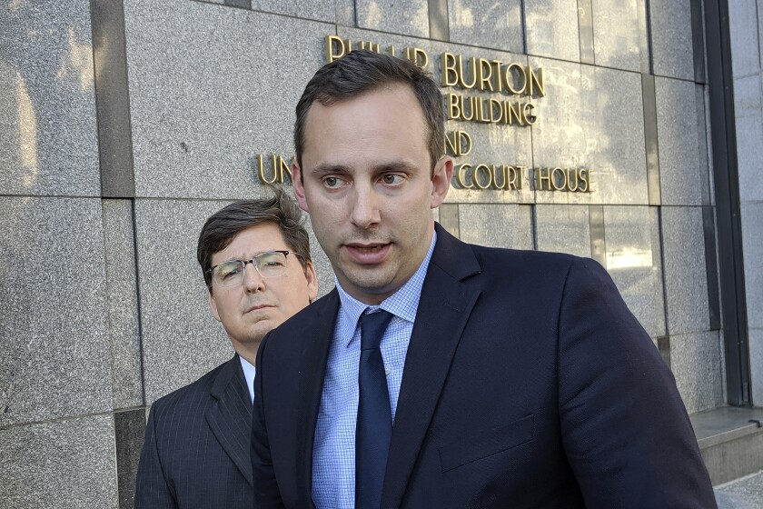 Anthony Levandowski in front of his attorney, Miles Ehrlich, outside of a federal courthouse in San Francisco.