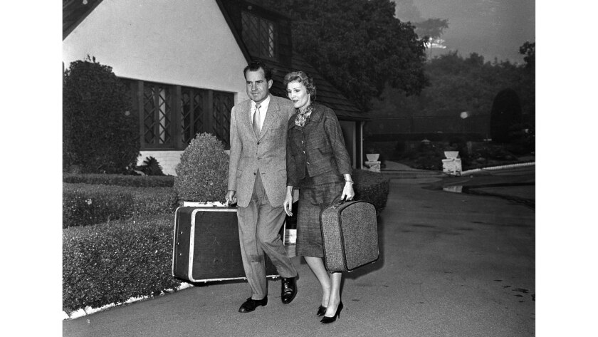 Nov. 6, 1961: Advancing flames force former Vice President Richard Nixon and his wife, Pat, to leave