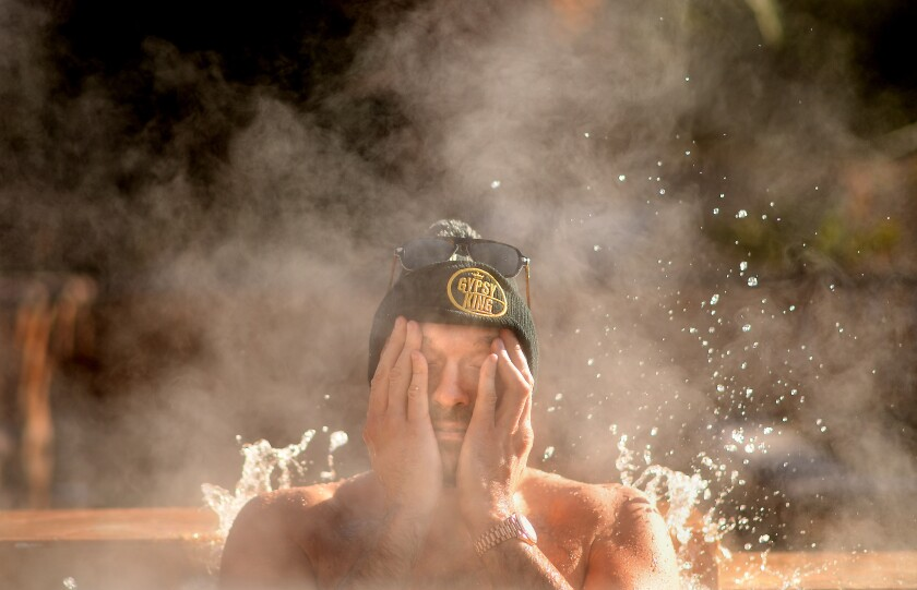 Boxer Tyson Fury sits in a jacuzzi following an early morning workout in Las Vegas.