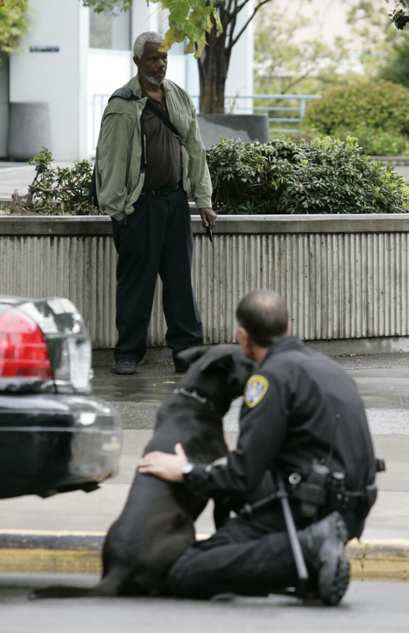 SDPD K9 handler Jim Stevens waited with his dog during the two-hour standoff with Mark Brown.