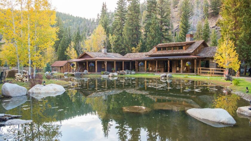 Reflections on the trout pond at Taylor River Lodge. Courtesy of Eleven Experience