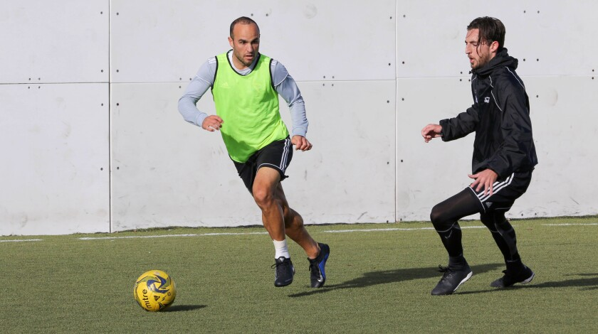Sockers' Landon Donovan moves the ball during practice Tuesday at Bradley Park in San Marcos. At right is teammate Travis Pittman.
