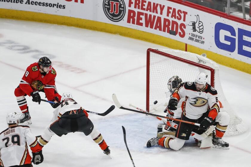 Blackhawks left wing Dominik Kubalik knocks a rebound past Ducks goaltender John Gibson during the second period of a game Jan. 11 at the United Center.
