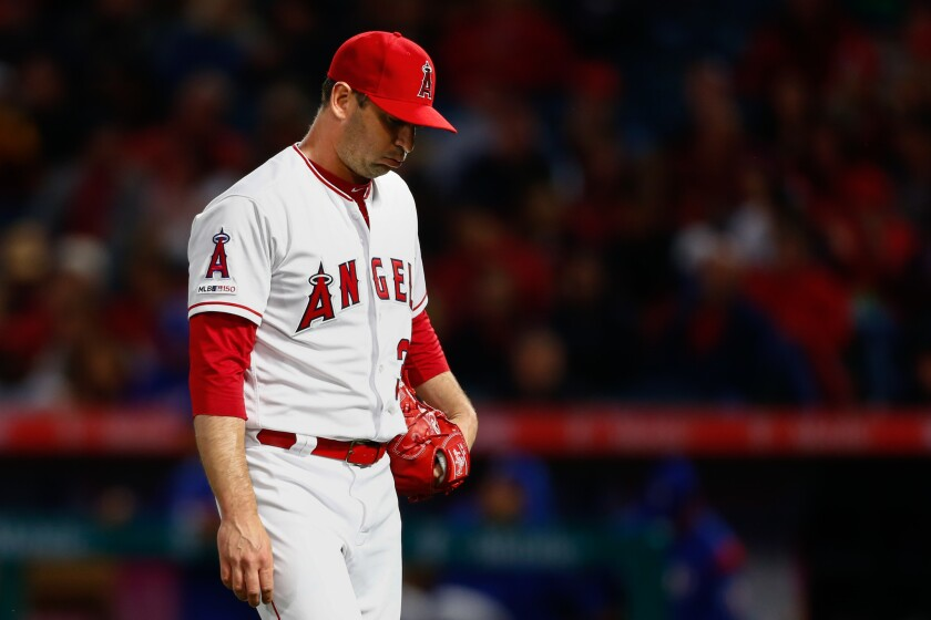 ANAHEIM, CALIF. - APRIL 04: Los Angeles Angels starting pitcher Matt Harvey (33) walks back to the d