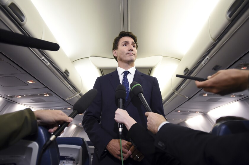 Canadian Prime Minister and Liberal Party leader Justin Trudeau makes a statement Sept. 18, 2019, on his campaign plane about a 2001 photo of himself in dark makeup.