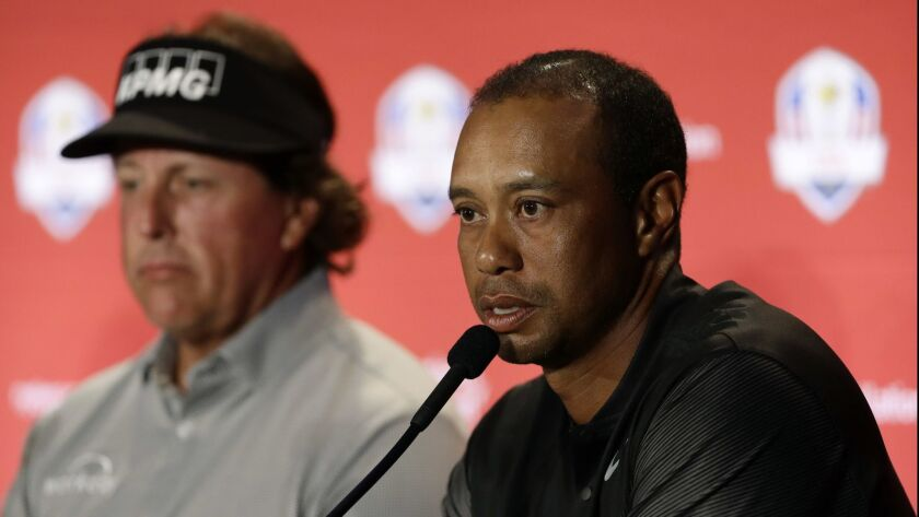 Tiger Woods, right, speaks during a news conference with Phil Mickelson, left, and others, where they were announced as captain's picks to the 2018 U.S. Ryder Cup Team, Tuesday, Sept. 4, 2018, in West Conshohocken, Pa.