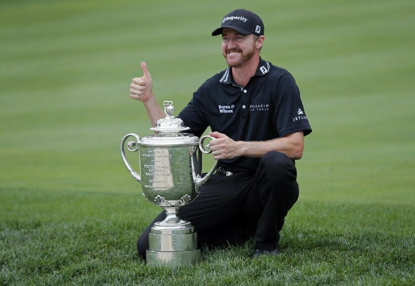 Jimmy Walker poses with the trophy after winning the PGA Championship golf tournament at Baltusrol Golf Club in Springfield, N.J., Sunday, July 31, 2016. (AP Photo/Tony Gutierrez)