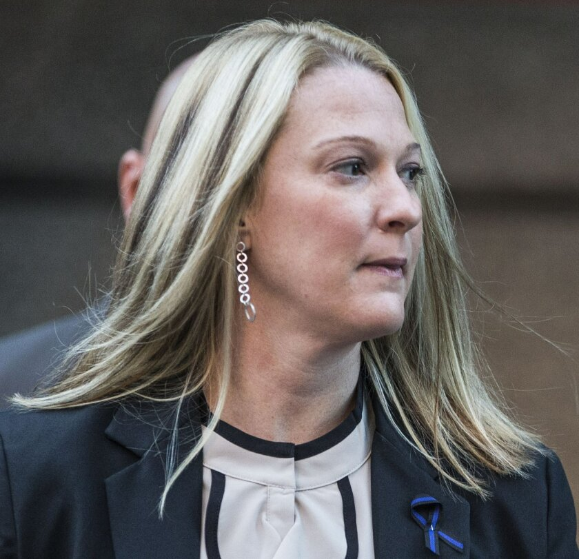 Suspended Hummelstown, Pa. Police Officer Lisa Mearkle enters the Dauphin County Courthouse on Friday, Oct. 30, 2015 for jury selection in Harrisburg, Pa. Mearkle is charged with third-degree murder, voluntary manslaughter and involuntary manslaughter for fatally shooting an unarmed man after he fl