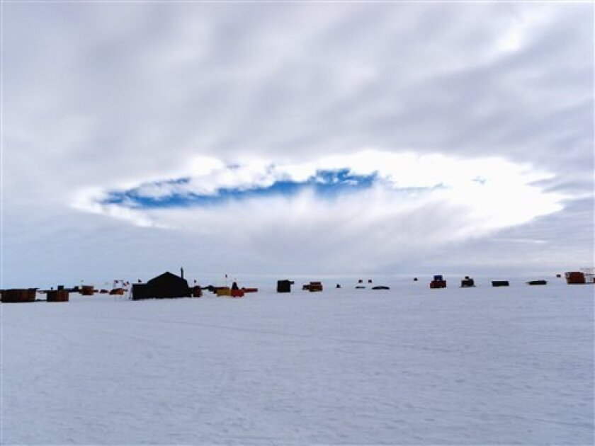 This handout photo, taken Dec. 12, 2009, provided by the journal Science shows an aircraft-induced hole observed at the West Antarctic Ice Sheet Divide Camp, Antarctica. Airplanes flying through supercooled clouds around airports can cause condensation that results in more snow and rain nearby, acc
