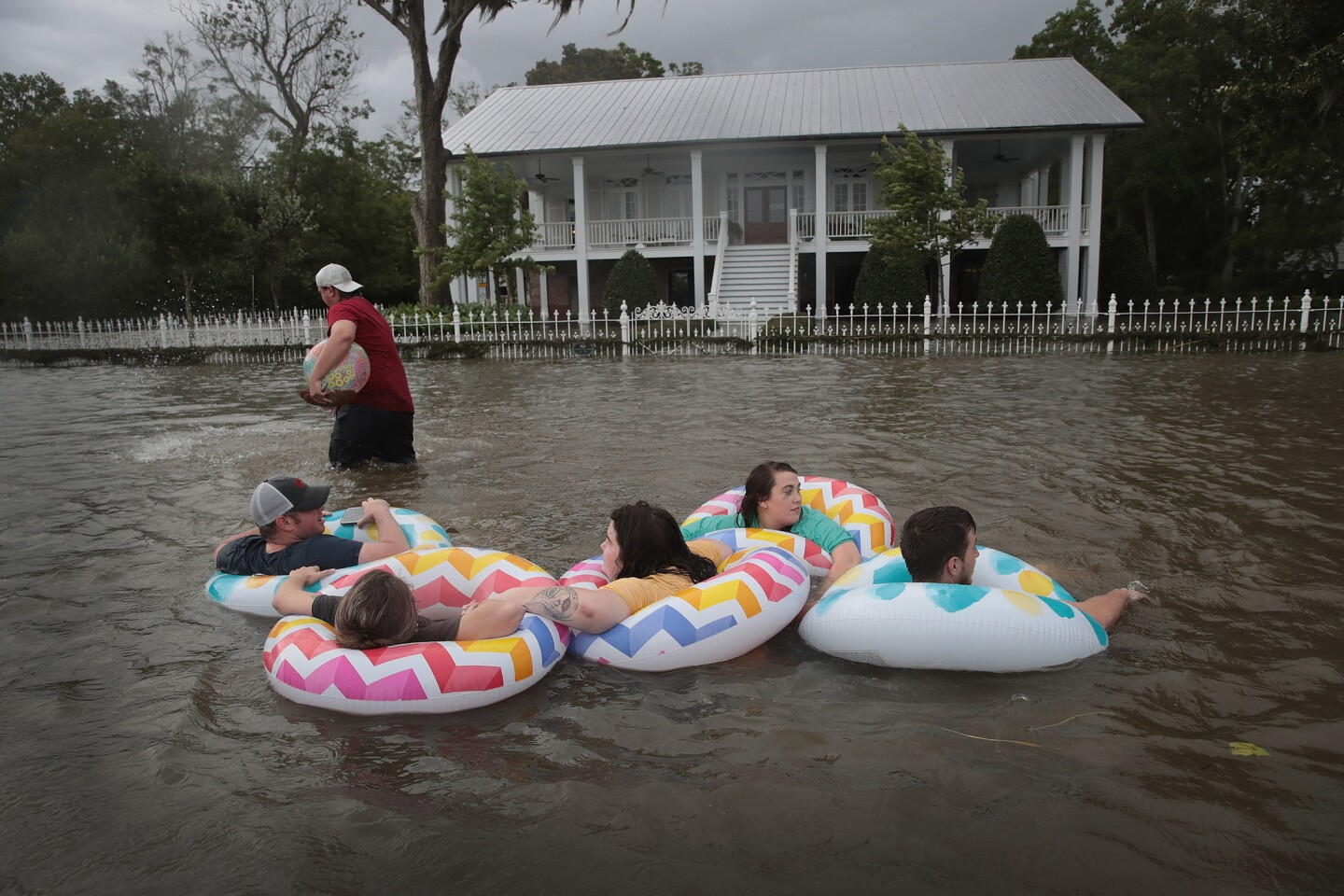 People float down Lakeshore Drive near Lake Pontchartrain after the Mandeville area flooded in the wake of Hurricane Barry.