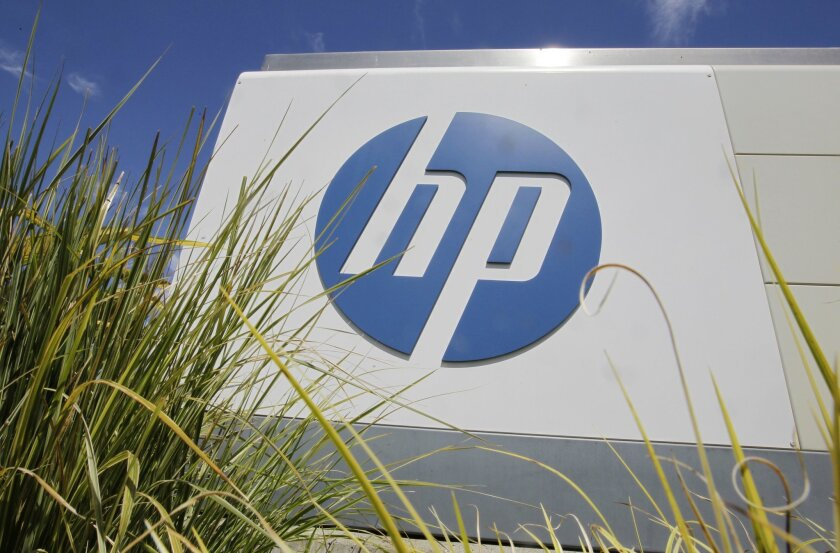 FILE - In this Aug. 21, 2012, file photo, the Hewlett-Packard Co. logo is seen outside the company's headquarters in Palo Alto, Calif. Hewlett-Packard Co. is splitting itself into two companies, one focused on its personal computer and printing business and another on technology services, such as data storage, servers and software, as it aims to drive stronger profitability. (AP Photo/Paul Sakuma, File)