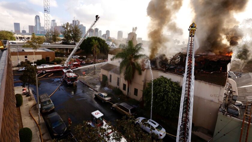LOS ANGELES CA OCTOBER 4, 2108 -- Firefighters work to extinguish a fire in an abandoned church bu