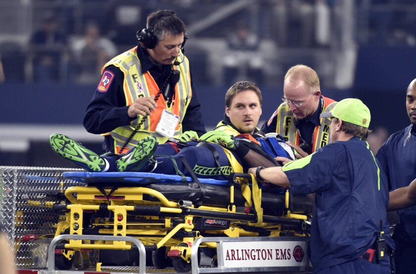 Medical staff prepare to cart off Seattle Seahawks' Ricardo Lockette in the first half of an NFL football game against the Dallas Cowboys Sunday, Nov. 1, 2015, in Arlington, Texas. (AP Photo/Michael Ainsworth)