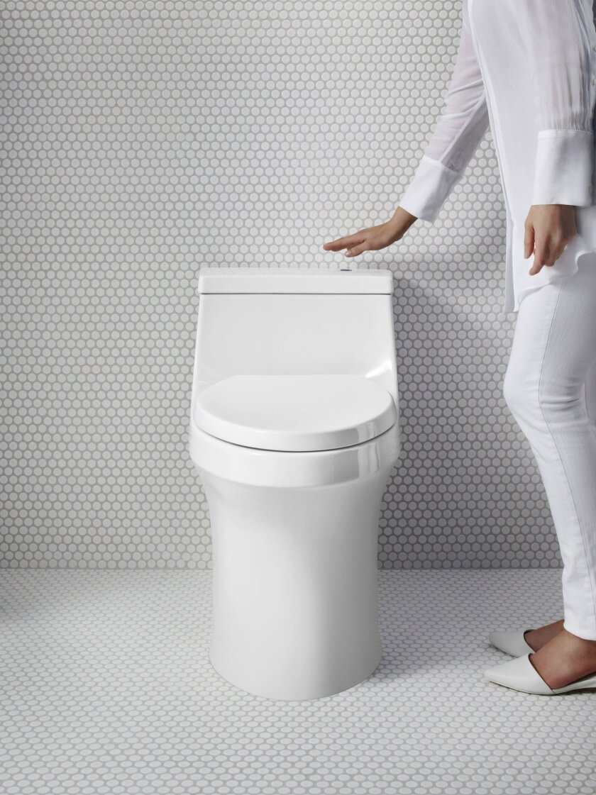 Hands-free toilet flushing is one of many facets to the trend of designing a home for healthy living.