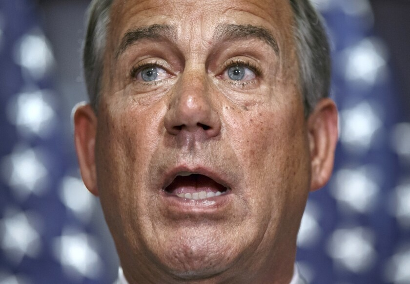 House Speaker John A. Boehner (R-Ohio) speaks at Republican National Committee headquarters in Washington on Tuesday. B